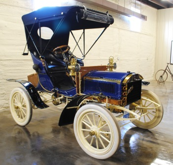 "The 1904 Mitchell Runabout is a small, light vehicle that was considered a ""ladies"" car when it came out, as it didn't require a lot of power to crank the motor or push the car while in neutral. This 1904 is shown with the optional top cover."