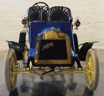 The 1906 Mitchell Runabout is shown without its top cover. Although light and without much power, when the top cover is removed, it is an exhilarating experience to go even 20 or 30 miles per hour down the road!
