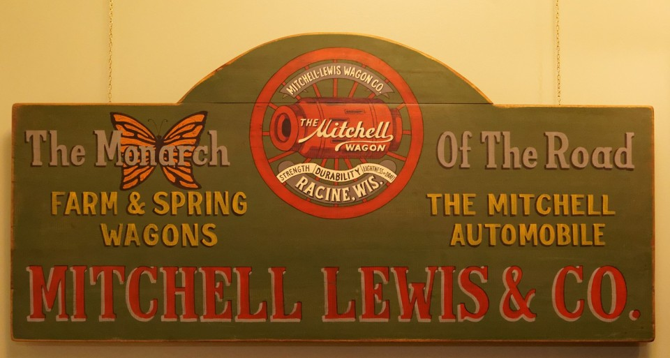 This sign hangs in the museum and incorporates one of the early Mitchell wagon slogans.