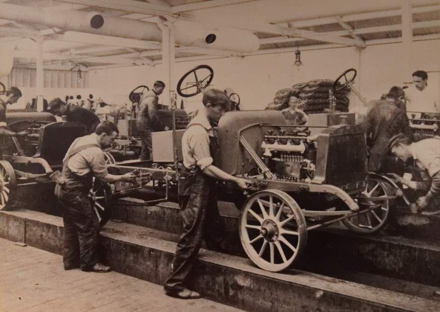 An assembly line was used at the automobile plant.