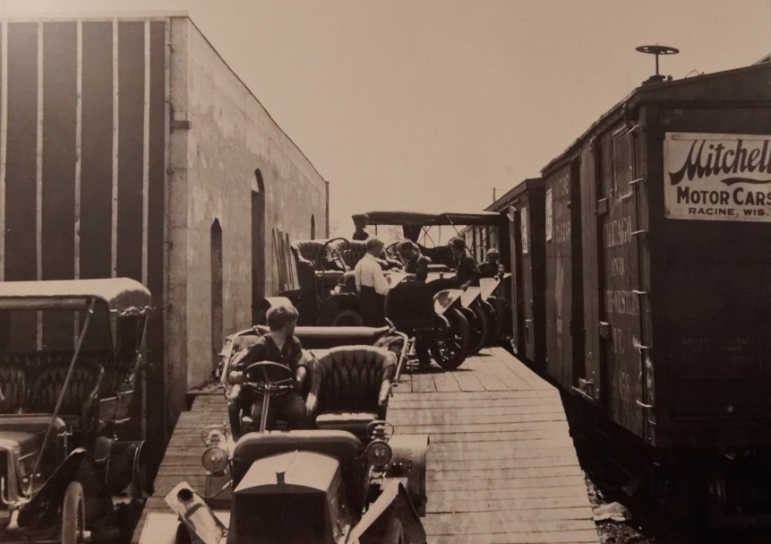 Automobiles and wagons were shipped by rail to all parts of the country.