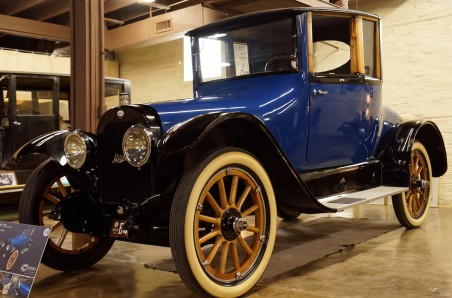 This is a 1919 3-Passenger Coupe. The top is removable, but it doesn't fold down into the car -- you have to set it on the floor of your garage.
