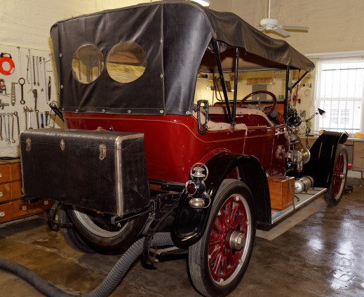 "The 1914 5-passenger touring car is in Lewis's shop for repairs. You can see why we call the rear storage compartment in our modern cars a ""trunk!"""